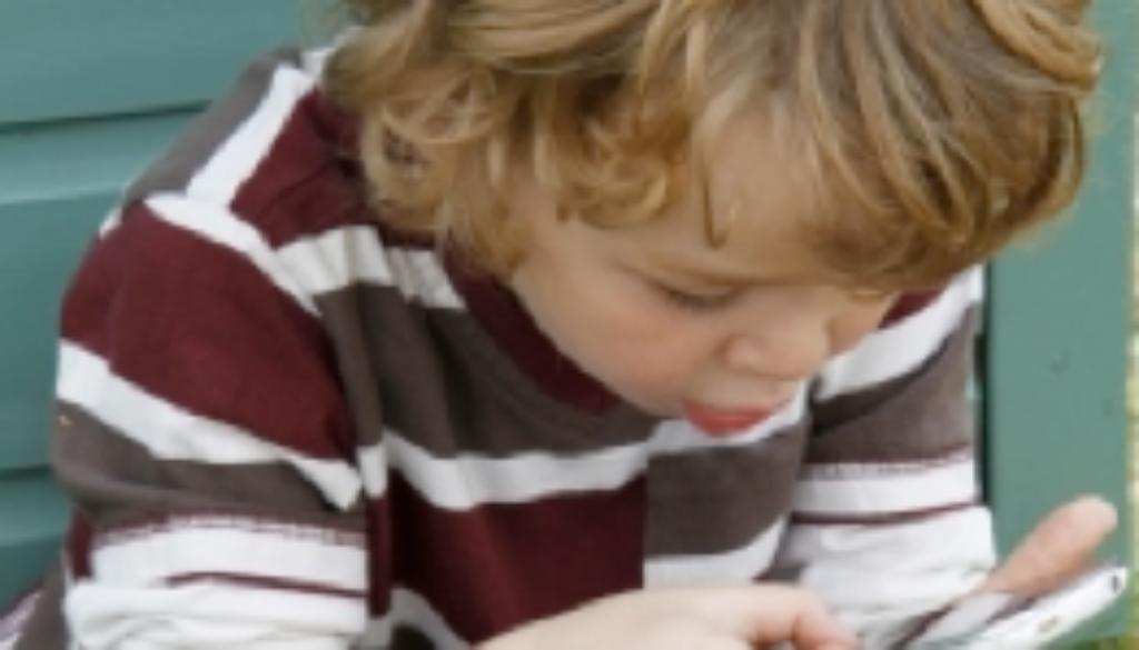 toddler playing phone app games avoid meltdown