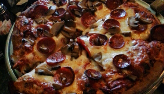 Green Lantern pepperoni and mushroom deep dish pizza