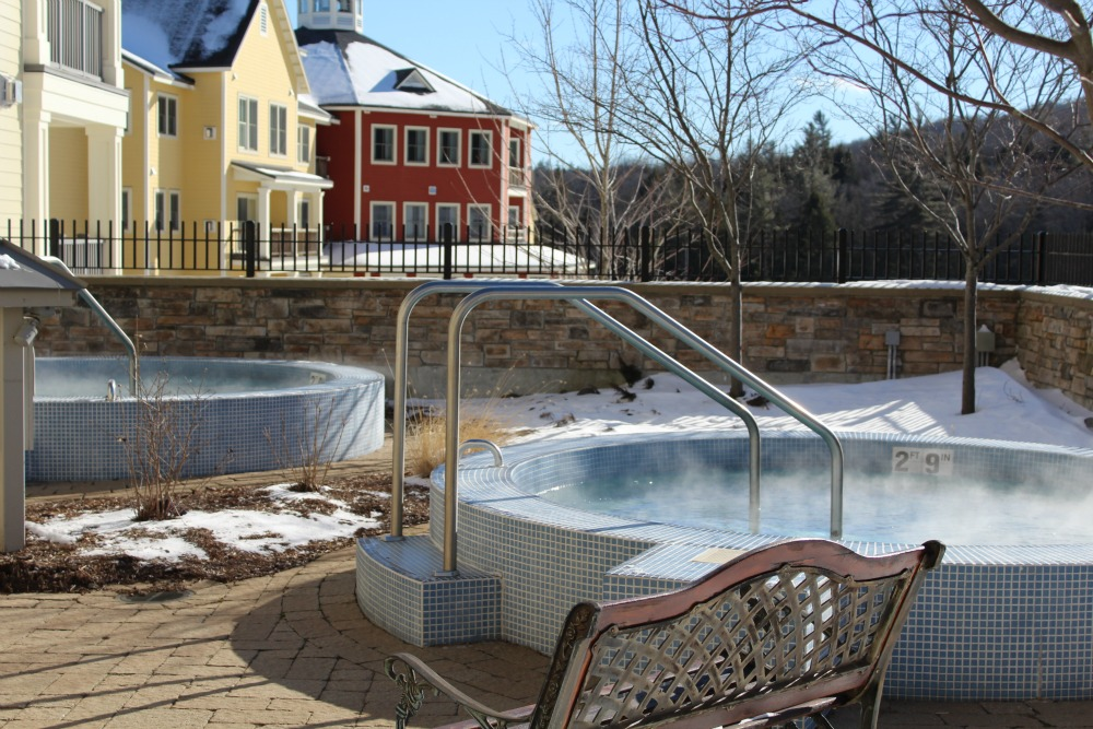 Outdoor hot tubs ate at Adams House at Okemo Mountain Resort