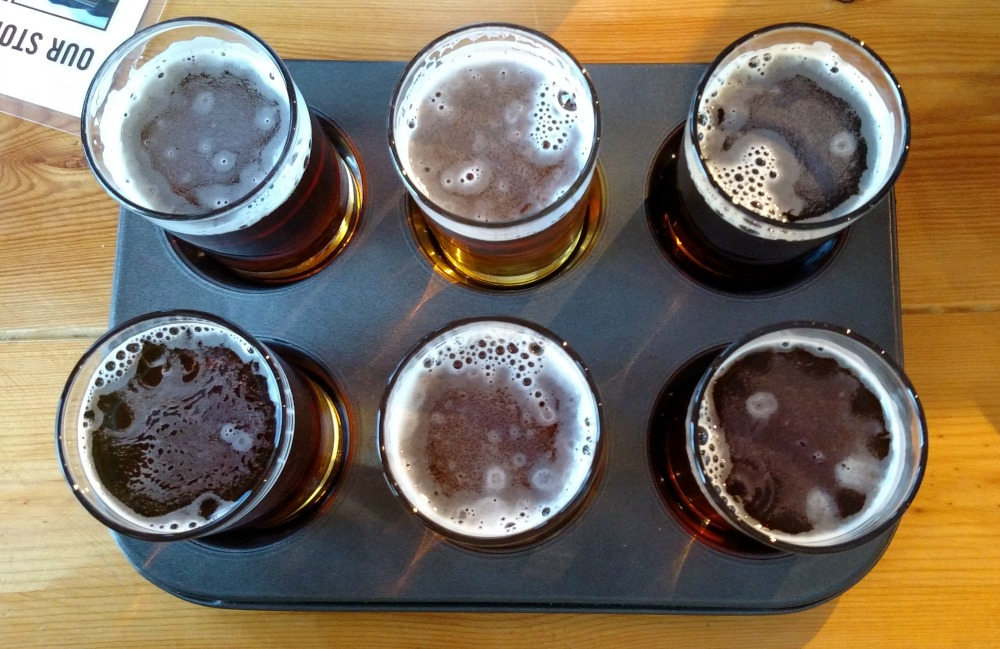 Long Train Brewing Company flight of beer is served in a muffin tin