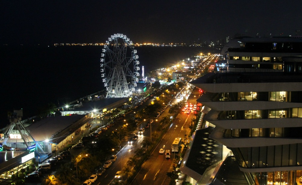 The city lights of Manila shine beautifully from the rooftop of the Microtel by Wyndham