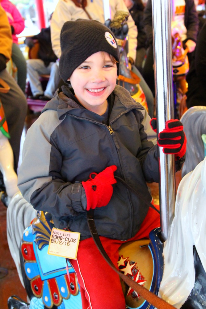 All smiles on the carousel at Hersheypark Candylane Christmas
