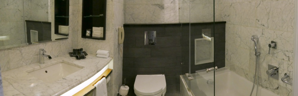 The bathroom at the Inbal Hotel was covered in marbled tile with sleek lines and modern amenities